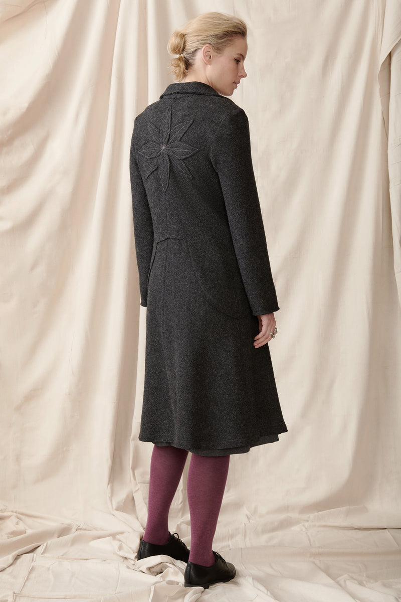 back of wool coat with applique detail and raw edges