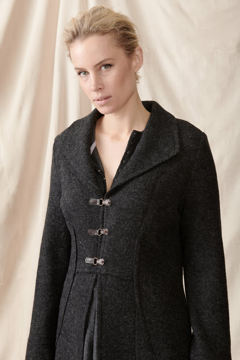 Front of charcoal wool coat leather and copperclasps