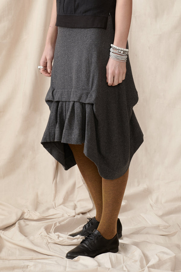 Asymmetrical hem charcoal skirt with front pleat detail