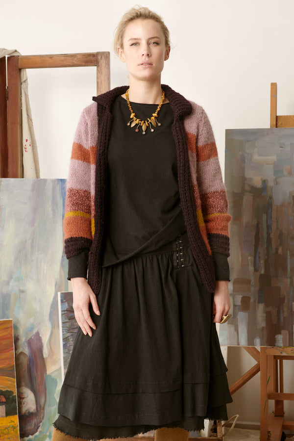 Black skirt with black long sleeved top and multi coloured cardigan