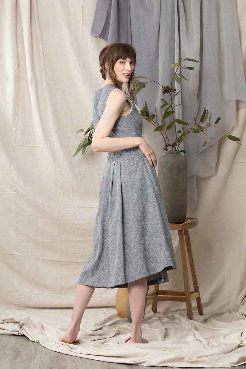 Back of sleeveless wrap dress in grey blue linen organic cotton.