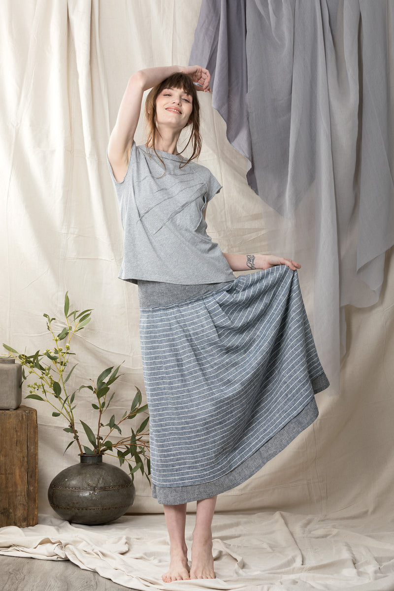 Organic stretch short sleeve top worn with a linen blue full skirt