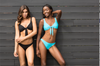 ISKKA's Gabrielle low rise bikini bottoms are self lining without tight seams around our hips. Best fitting bottoms. Seen here in black and light blue with our matching Suzie Sailor tops.