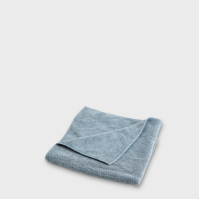 grey microfibre work cloth to scale grey background