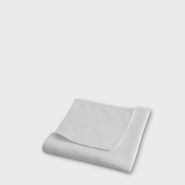 white microfibre work cloth to scale grey background