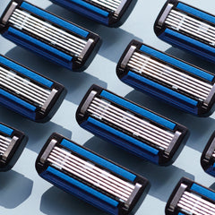 5 Blade subscription razors laid out in diagonal pattern