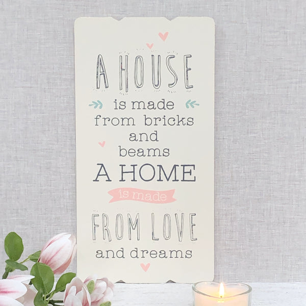 A house is made from bricks and beams a home is love & dreams