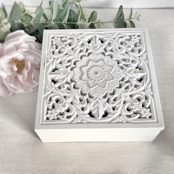White carved storage boxes