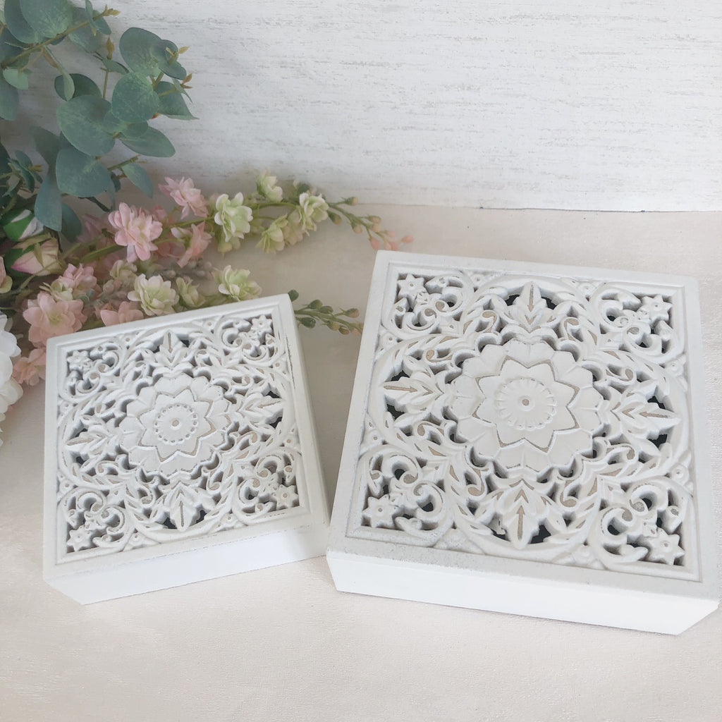 White carved trinket storage boxes