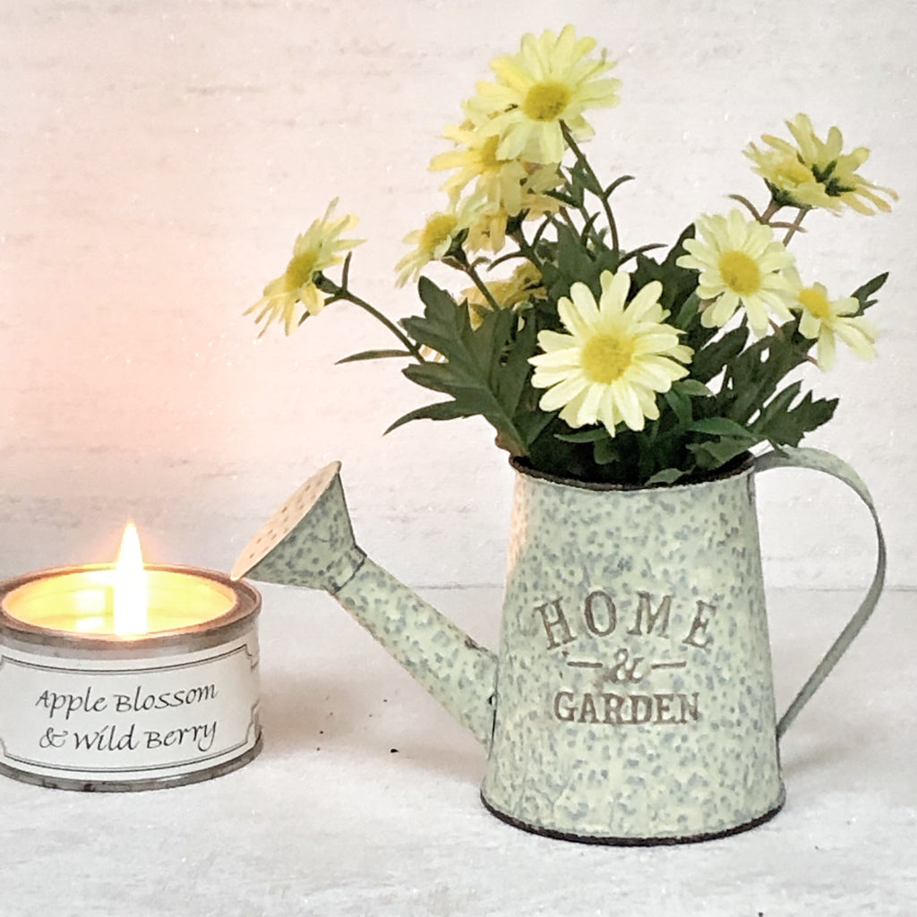 Yellow Flowers Potted In Small Jug