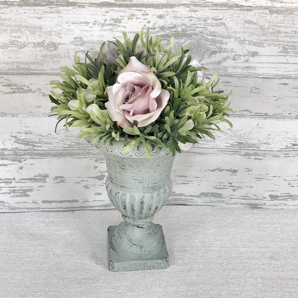 Grey vase with faux flowers