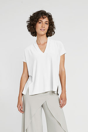 Sympli Short Sleeve Deep V Top in White.  V neck with short sleeves and 2 front slits at hem.  Boxy shape. Soft drape._23508356694216