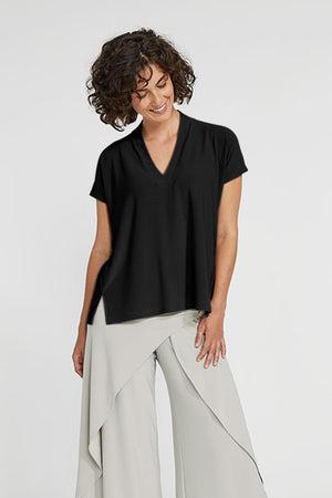 Sympli Short Sleeve Deep V Top in Black.  V neck with short sleeves and 2 front slits at hem.  Boxy shape. Soft drape._23508357054664