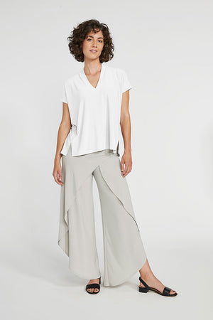 Sympli Short Sleeve Deep V Top in White.  V neck with short sleeves and 2 front slits at hem.  Boxy shape. Soft drape._23508356792520