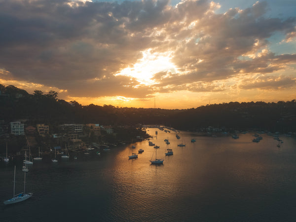 Sailors Bay - Golden Hour - Luxury waterfront properties and boats in Sydney, Australia