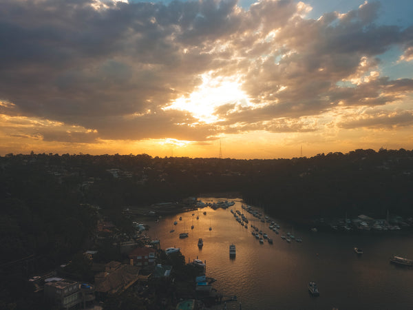 Sunset and houses at Minimbah Rd, Sailors Bay - Waterfront properties and boats