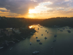 Sunset at Sailors Bay - Luxury houses and sailboats - Taken close to Mowbray Point, Minimbah Road and Clive Park - Stock Photo
