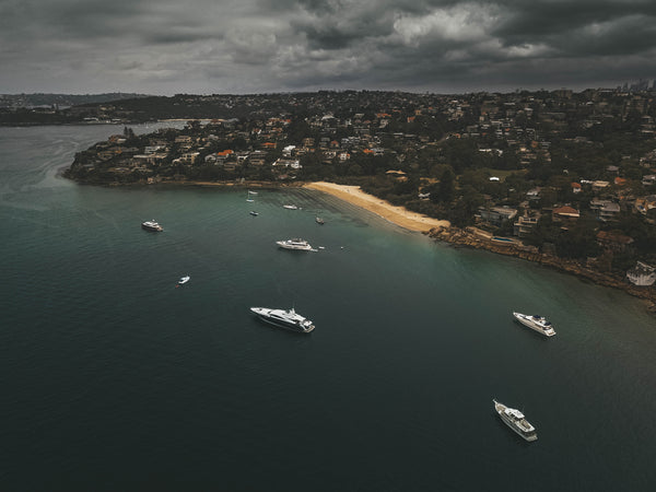 Chinamans Beach at Sydney - Boats and stormy weather - Stock photo