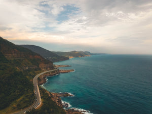 Free Stock Image of Australian coast, Sea Cliff Bridge and beautiful sun shinning through the clouds
