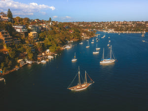 Luxury properties and sailboats at Seaforth Bluff in Sydney, NSW, Australia