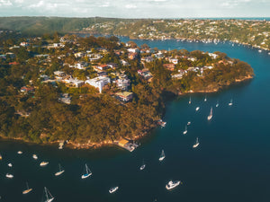 Drone image of houses and private boats over the Sailors Bay - Linden Way Reserve