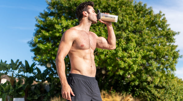 Man drinking Transformation Protein Powder
