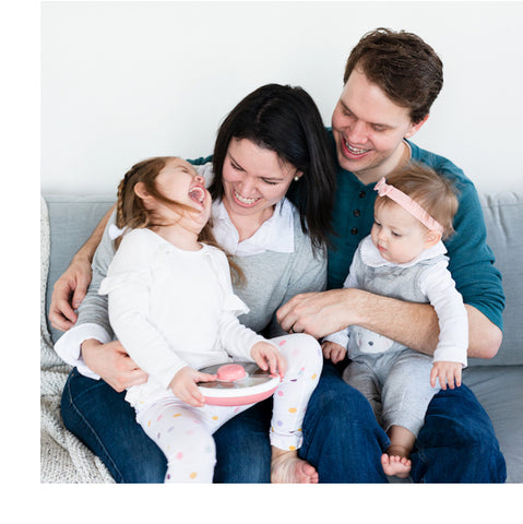 Mom and dad with daughters (3 and 1 years old) playing together
