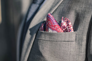 Red paisley silk pocket square geometric pattern gray suit