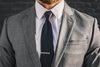 black woven grenadine tie silk gray suit foundation menswear