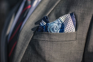 Navy Paisley silk pocket square blue polka dots white border foundation menswear gray suit