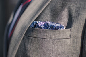 Navy silk pocket square micro chain pattern light blue paisley foundation menswear gray suit