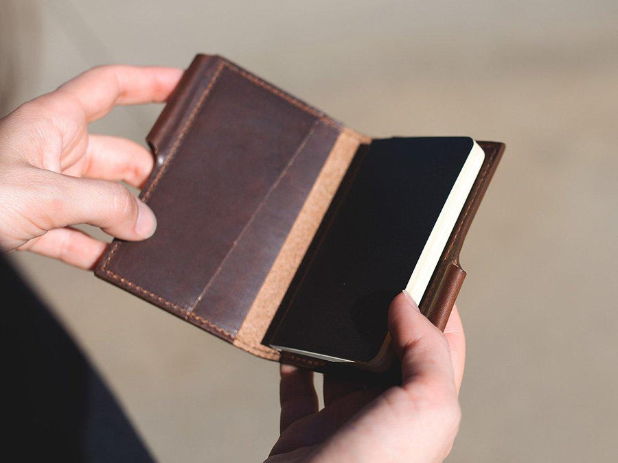 image of mini journal with pen in horween chestnut leather
