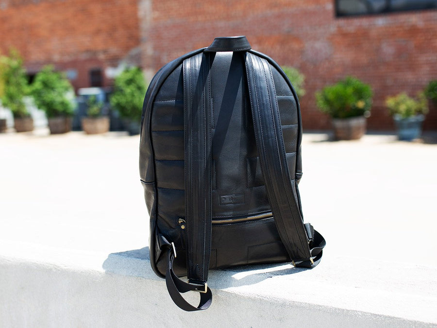 photo of backpack made of denim and horween leather