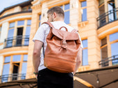 unisex leather backpack of tawny color - image