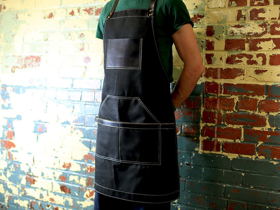 photo of leather and waxed canvas apron black