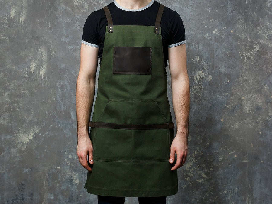 image of green apron with logo engraving