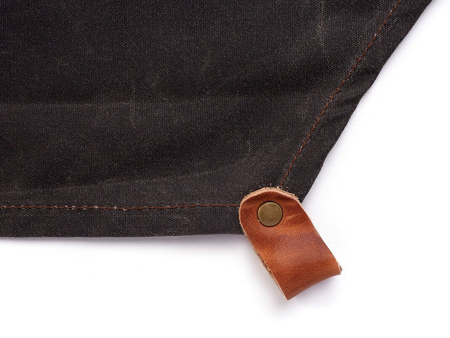 custom apron in waxed canvas of dark brown color