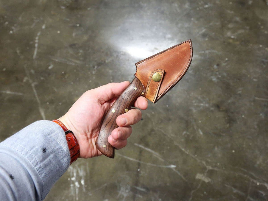 knife in leather holder