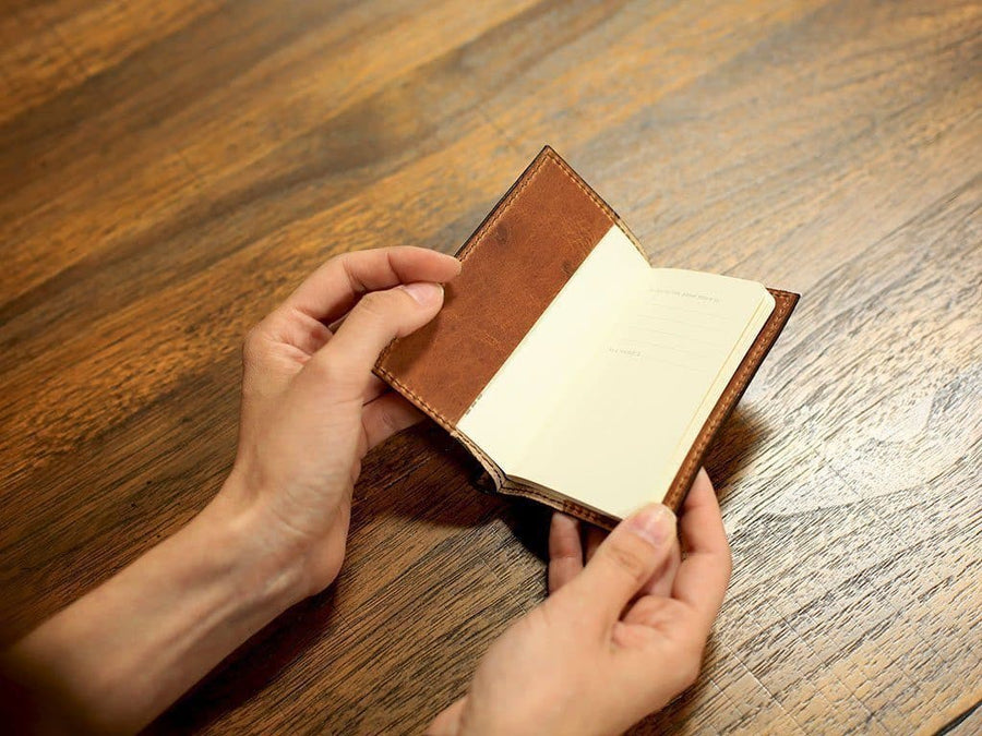 photo of natural mini notebook with pen in horween leather