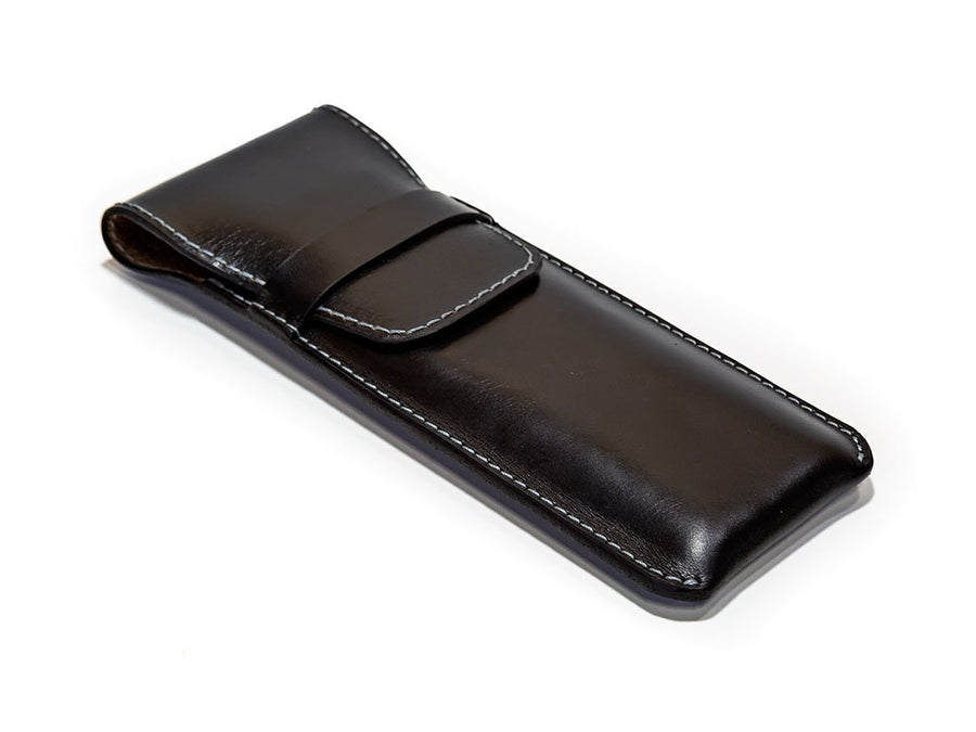 photo of black leather pen holders and rolls by olpr.