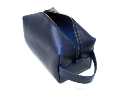photo of blue leather toiletry bag with handle