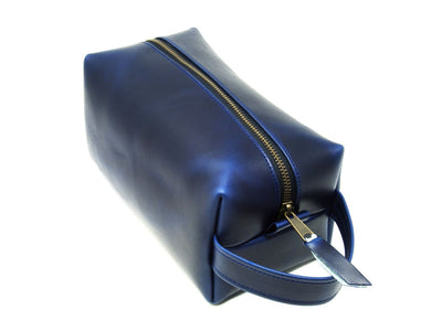 photo of blue leather dopp kit with handle