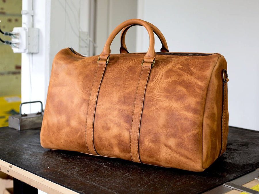image of natural leather duffle bag