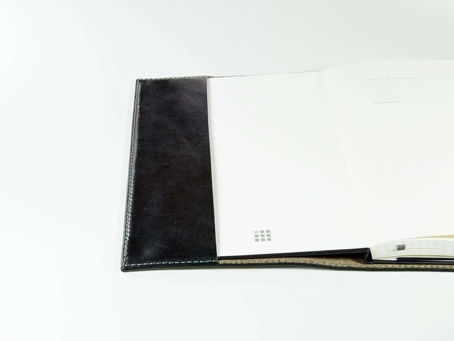 image of handmade black leather pocket journal