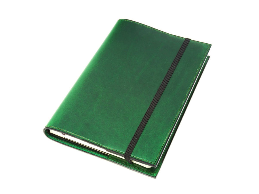 photo of green horween leather moleskine classic notebook cover