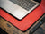 photo of red work desk leather cover