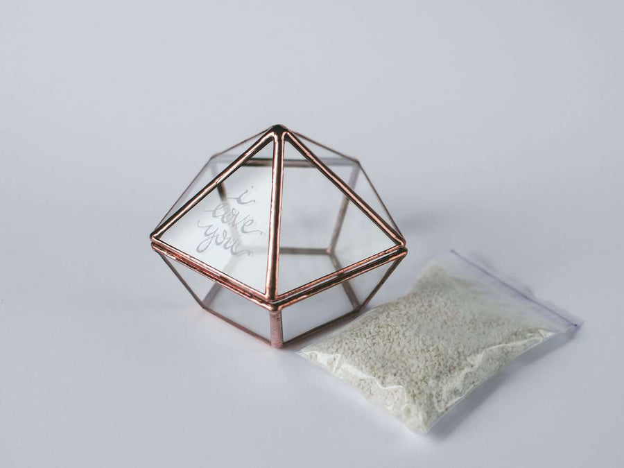 image of glass and metal geometric ring box