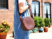 circle leather bag of brown color