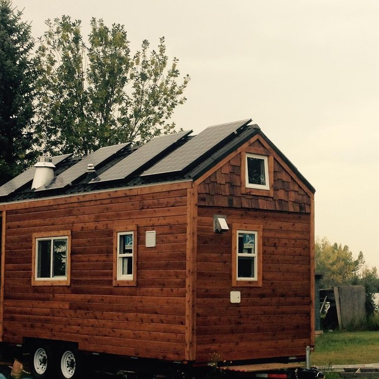 tiny house with four solar panels
