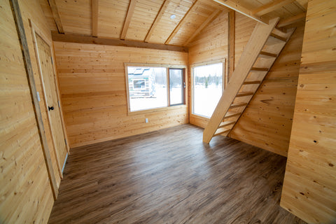 The interior of the red tiny house by tiny life supply